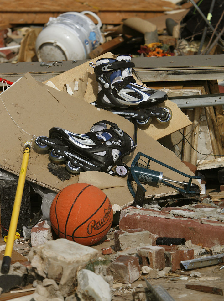 Photo - Damage left behind from a home in the Oak Tree addition on Wednesday, Feb. 11, 2009, after a tornado hit the area on Tuesday in Edmond, Okla.  PHOTO BY CHRIS LANDSBERGER, THE OKLAHOMAN