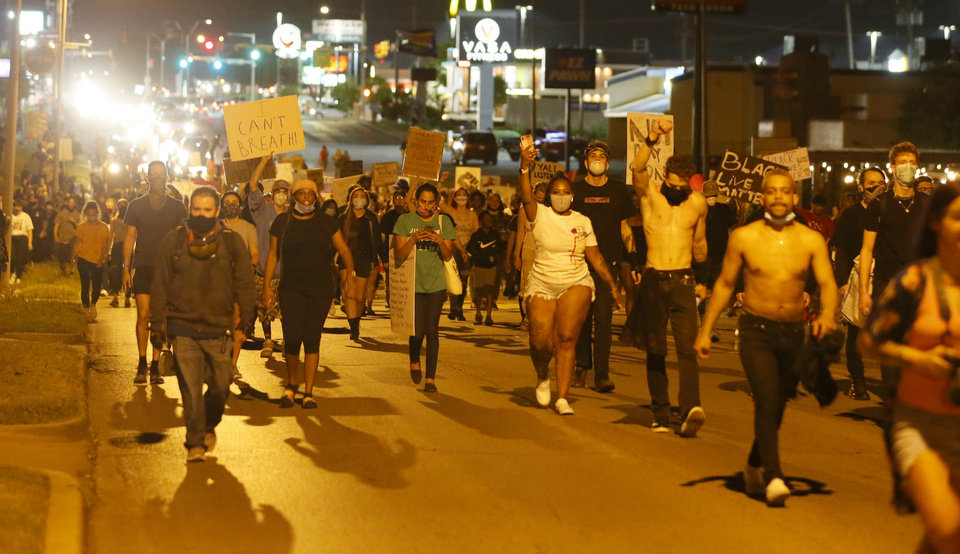 Photo - Protesters march along NW 23rd in Oklahoma City, Saturday, May 30, 2020. The protest was in response to the death of George Floyd. [Bryan Terry/The Oklahoman]