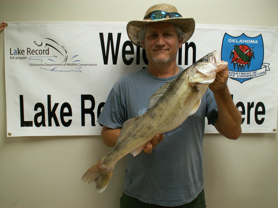 Photo -  Scott Elam of Moore with a walleye from Lake Stanley Draper