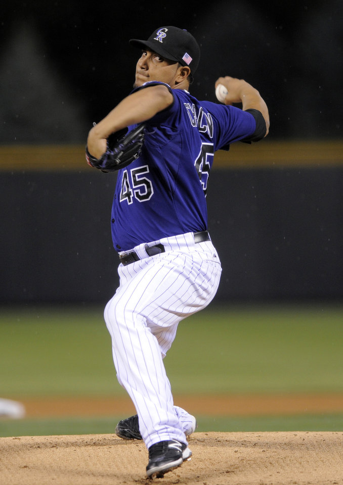 Photo -   Colorado Rockies starting pitcher Jhoulys Chacin throws against the San Francisco Giants during the first inning of a baseball game Tuesday, Sept. 11, 2012, in Denver. (AP Photo/Jack Dempsey)