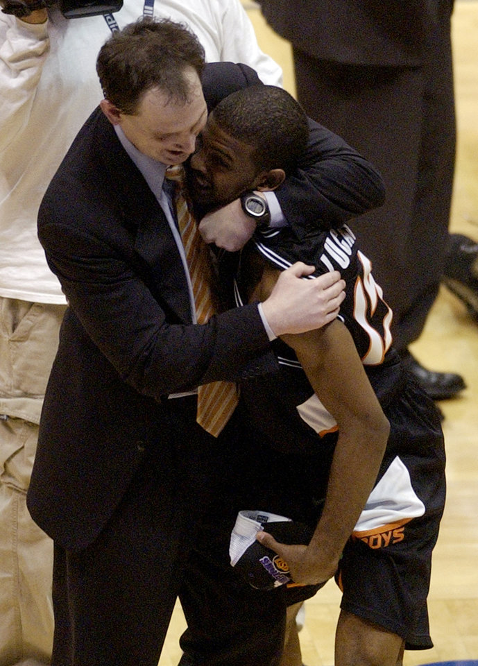 Photo - OSU COLLEGE BASKETBALL: Oklahoma State University's assistant coach Sean Sutton, left,  hugs John Lucas after their 64-62 win over Saint Joseph's  in the NCAA tournament regional final in East Rutherford, NJ  Saturday, March 27, 2004. (AP Photo/Julie Jacobson)