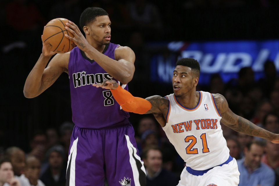 Photo - New York Knicks' Iman Shumpert (21) defends Sacramento Kings' Rudy Gay (8) during the first half of an NBA basketball game Wednesday, Feb. 12, 2014, in New York.  (AP Photo/Frank Franklin II)