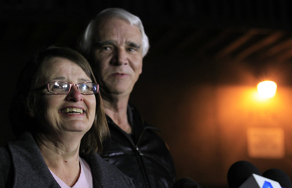 FILE - This Wednesday Feb. 13, 2013 file photo shows Karen Reynolds, 57, and her husband, Jim Reynolds, 66, during a news conference in Big Bear Lake, Calif. recounting their experience of being held captive by fugitive Christopher Dorner inside a condo unit they own at Mountain Vista Resort. (AP Photo/Los Angeles Times, Brian van der Brug, File) NO FORNS; NO SALES; MAGS OUT; ORANGE COUNTY REGISTER OUT; LOS ANGELES DAILY NEWS OUT; VENTURA COUNTY STAR OUT; INLAND VALLEY DAILY BULLETIN OUT; MANDATORY CREDIT, TV OUT
