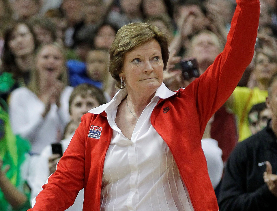 In this April 1, 2012, file photo, Tennessee coach Pat Summitt waves to the crowd during a half-time ceremony to honor past olympic coaches at an NCAA women\'s Final Four semifinal college basketball game between the Baylor and the Stanford in Denver. Summitt, the sport\'s winningest coach, is stepping aside as Tennessee\'s women\'s basketball coach and taking the title of
