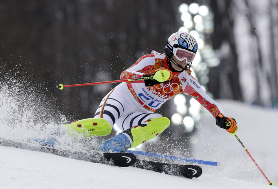 Photo - Germany's Maria Hoefl-Riesch skis to the gold medal in the women's supercombined in the Sochi 2014 Winter Olympics, Monday, Feb. 10, 2014, in Krasnaya Polyana, Russia. (AP Photo/Luca Bruno)