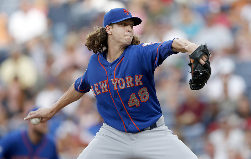 Photo - New York Mets starting pitcher Jacob deGrom (48) works in the first inning of a baseball game against the Atlanta Braves in Atlanta, Wednesday, July 2, 2014. (AP Photo/John Bazemore)