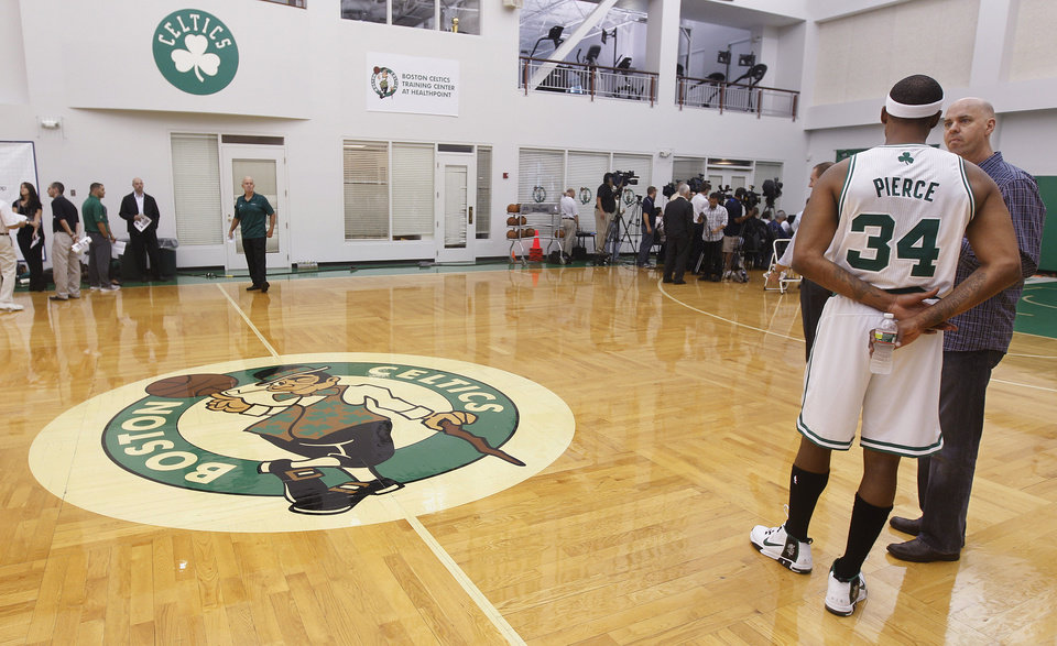 Photo -   Boston Celtic forward Paul Pierce (34) talks to a reporter during media day at the NBA basketball team's training center in Waltham, Mass., Friday, Sept. 28, 2012. (AP Photo/Stephan Savoia)