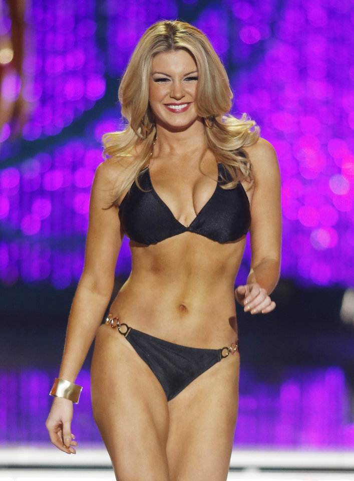 Photo - Miss New York Mallory Hytes Hagan competes in the swimsuit portion of the Miss America 2013 pageant on Saturday, Jan. 12, 2013, in Las Vegas. (AP Photo/Isaac Brekken)