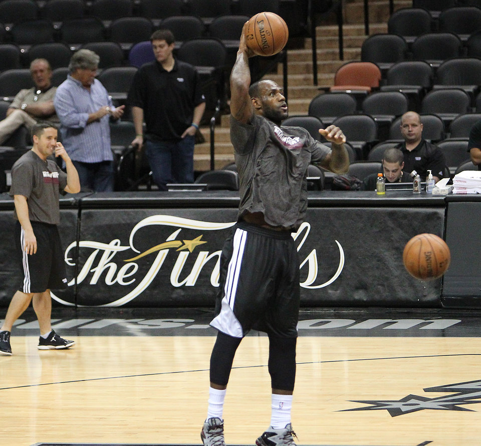 Photo - Miami Heat forward LeBron James shoots during NBA basketball practice, Saturday, June 15, 2013, in San Antonio. The Heat take on the San Antonio Spurs in Game 5 of the NBA Finals on Sunday, with the best-of-seven games series even at 2-2.(AP Photo/El Nuevo Herald, David Santiago)  MAGS OUT