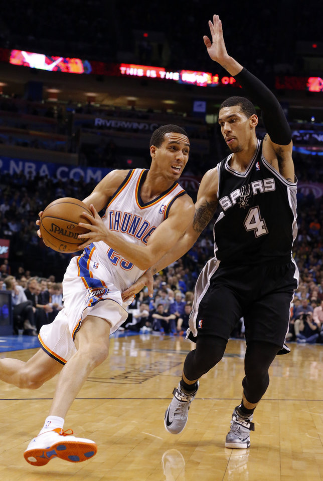 Photo - Oklahoma City's Kevin Martin (23) drives to the basket as San Antonio's Danny Green (4) defends during the NBA game between the Oklahoma City Thunder and the San Antonio Spurs at the Chesapeake Energy Arena, Thursday, April 4, 2013. Photo by Sarah Phipps, The Oklahoman