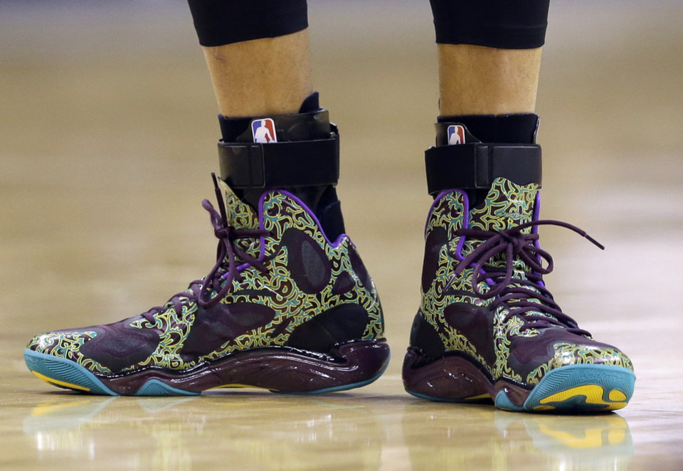 Photo - Golden State Warriors' Stephen Curry shoes a seen during the first half of an NBA basketball game against the Indiana Pacers Tuesday, March 4, 2014, in Indianapolis. (AP Photo/Darron Cummings)