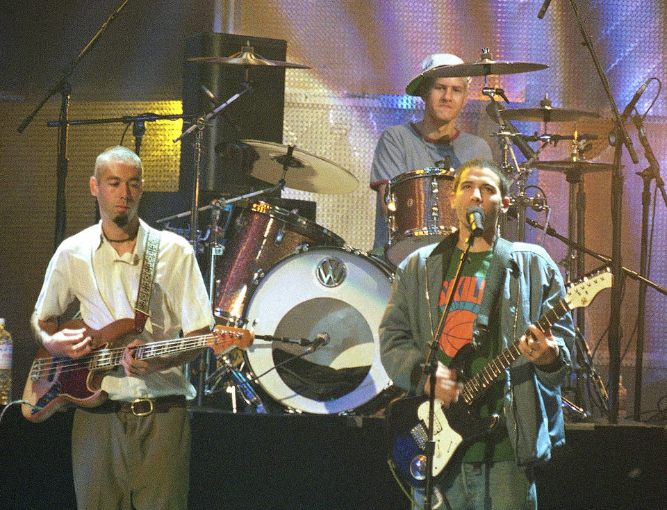 FILE - In this Sept. 7, 1994 file photo, members of the Beastie Boys, Adam Yauch, known as MCA, left, Adam Horovitz, known as Adrock, foreground right, and Michael Diamond, known as Mike D, rehearse at Radio City Music Hall in New York. Yauch, the gravelly voiced Beastie Boys rapper who co-founded the seminal hip-hop group, has died at age 47. The cause of death wasn't immediately known. Yauch, who's also known as MCA, was diagnosed with a cancerous parotid gland in 2009.(AP Photo/Justin Sutcliffe, file)