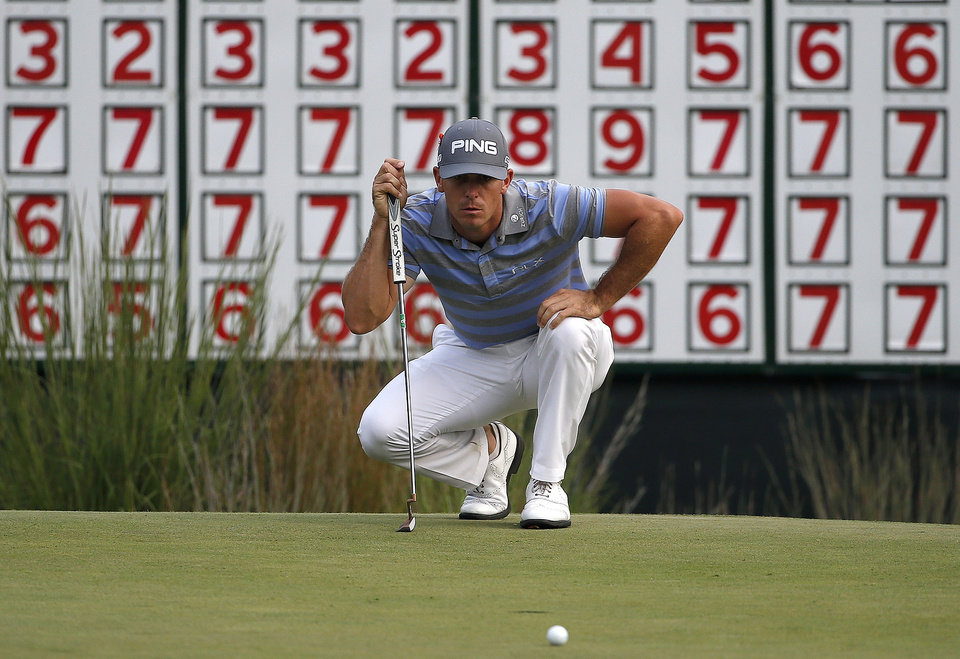 Photo - Billy Horschel lines up a putt on the 18th hole during the third round of the Deutsche Bank Championship golf tournament in Norton, Mass., Sunday, Aug. 31, 2014. (AP Photo/Michael Dwyer)