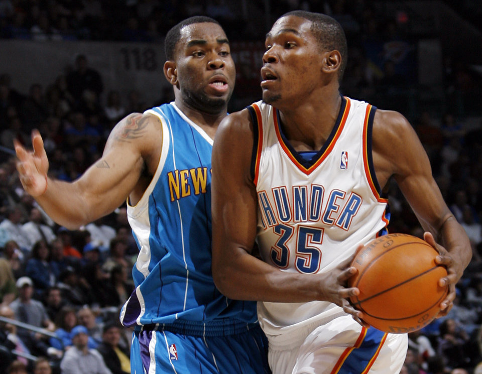 Photo - Oklahoma City's Kevin Durant (35) drives past Marcus Thornton (5) of New Orleans during the NBA basketball game between the New Orleans Hornets and the Oklahoma City Thunder at the Ford Center in Oklahoma City, Wednesday, March 10, 2010. Oklahoma City won, 98-83. Photo by Nate Billings, The Oklahoman ORG XMIT: KOD