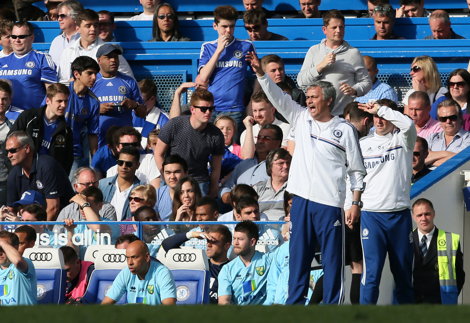 Photo - Chelsea manager Jose Mourinho gestures as he watches their English Premier League soccer match against Norwich City at Stamford Bridge stadium in London, Sunday May 4, 2014. (AP Photo/Alastair Grant)