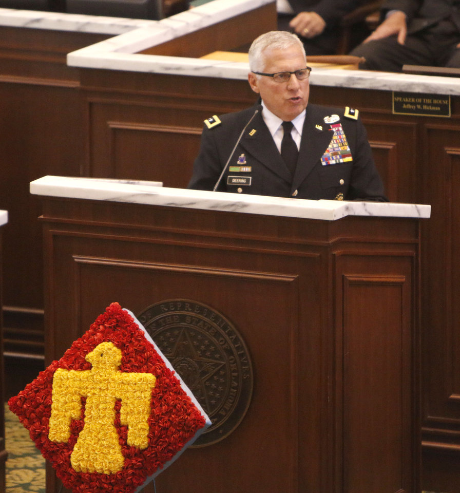 Photo -  Maj. Gen. Myles Deering, adjutant general of Oklahoma, speaks on the floor of the Oklahoma House of Representatives during a joint session of the Oklahoma Legislature on Tuesday in Oklahoma City. PHOTO BY PAUL HELLSTERN, THE OKLAHOMAN   PAUL HELLSTERN -
