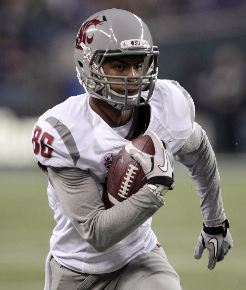 Photo -   FILE - This Nov. 26, 2011 file photo shows Washington State's Marquess Wilson returning a reception for a 38-yard touchdown during the second half of an NCAA college football game against Washington, in Seattle. The star receiver's allegations that he has been physically and emotionally abused by coaches have roiled Washington State, and the school president has called for an investigation of Marquess Wilson's complaints against new coach Mike Leach and his staff. Wilson on Saturday, Nov. 10, 2012, quit the team, saying coaches