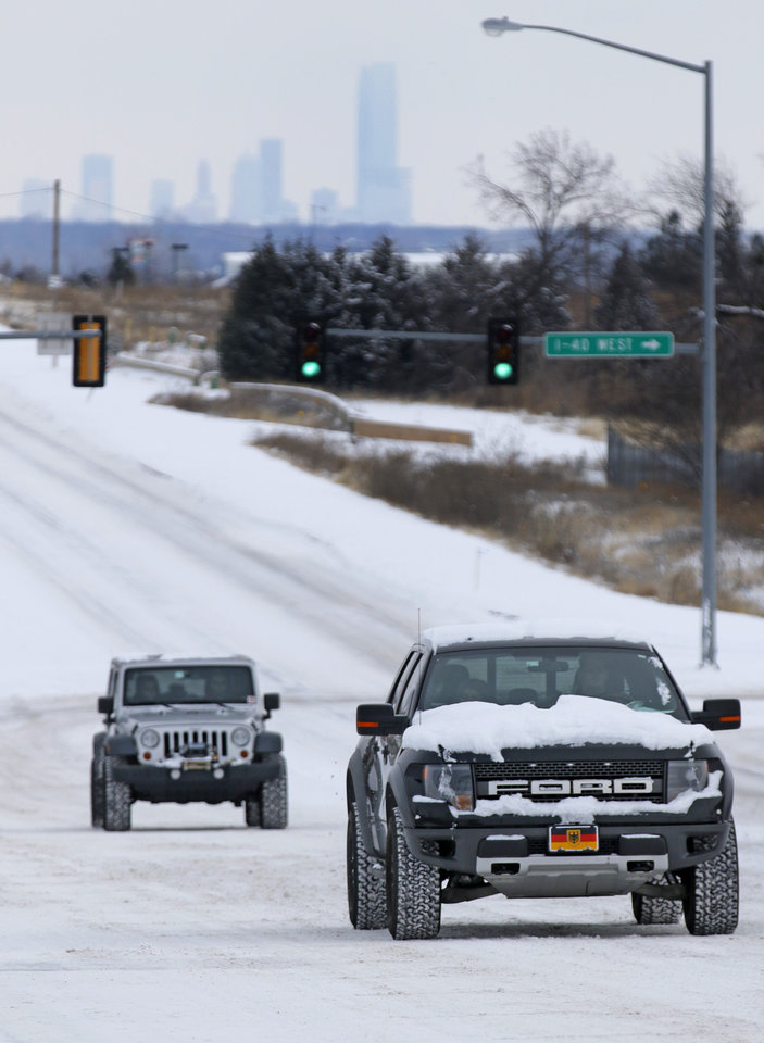 Photo - Motorist make their way up a hill on NW 10th street in Yukon, Friday January, 6 2017. Photo By Steve Gooch, The Oklahoman