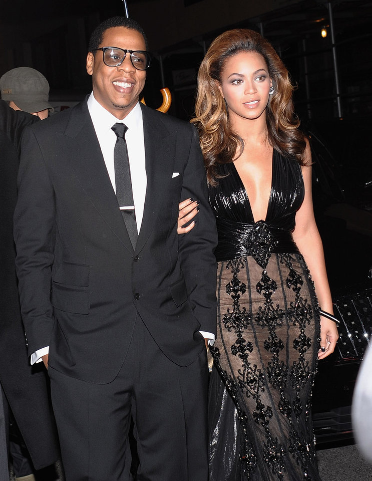 Photo - FILE- In this Dec. 1, 2008 file photo, Hip-hop singer and entrepreneur Jay-Z and his wife singer-actress Beyonce Knowles attend the premiere of