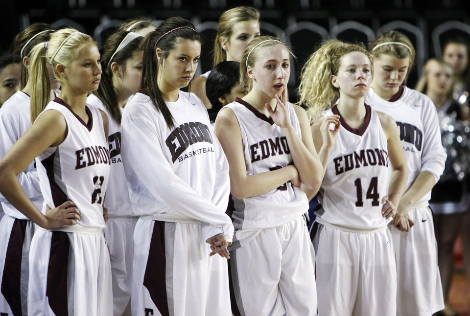 The Edmond Memorial Lady Bulldogs stand together after the Class 6A girls high school basketball state tournament championship game between Edmond Santa Fe and Edmond Memorial at the Mabee Center in Tulsa, Okla., Saturday, March 10, 2012. Santa Fe won, 44-41. Photo by Nate Billings, The Oklahoman