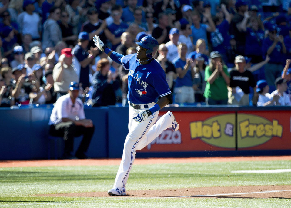 Photo -   Toronto Blue Jays' Adeiny Hechavarria rounds the bases after hitting a two-run home run against the Boston Red Sox during the seventh inning of a baseball game in Toronto on Sunday, Sept. 16, 2012. (AP Photo/The Canadian Press, Nathan Denette)