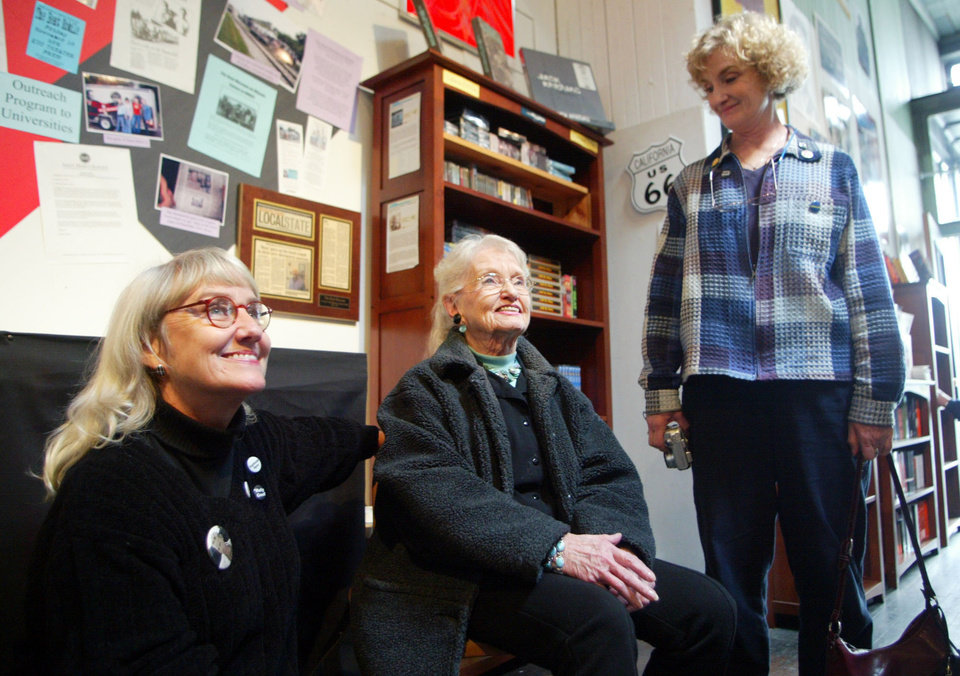 "File-This Jan.16, 2006 file photo shows late Beat writer Neal Cassady's  daughter, Jami Cassady, left, his wife, Carolyn Cassady, center, and daughter, Cathy Cassady, smiling while visiting ""The Beat Museum,"" in the North Beach district of San Francisco.  A longtime friend of Carolyn Cassady has confirmed the writer who was the former wife of Beatnik Neal Cassady and lover of Jack Kerouac has died. She was 90 years old. Estelle Cimino, co-owner of the Beat Museum in San Francisco, said Saturday Sept. 21, 2013 that Carolyn Cassady died Friday Sept. 20, 2013 in the United Kingdom (AP Photo/George Nikitin, File)"