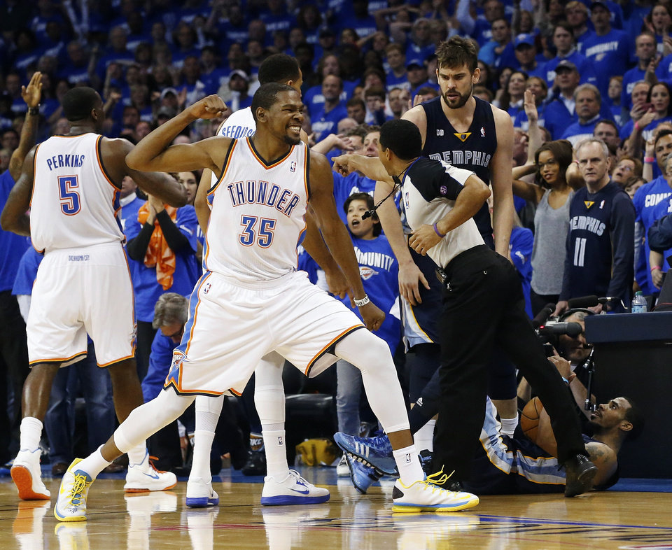 Photo - Oklahoma City Thunder forward Kevin Durant (35) reacts after Memphis Grizzlies guard Mike Conley, bottom right, was called out-of-bounds and the ball awarded to the Thunder in the fourth quarter of Game 1 of their Western Conference semifinal NBA basketball playoff series in Oklahoma City, Sunday, May 5, 2013. Oklahoma City won 93-91. (AP Photo/Sue Ogrocki)