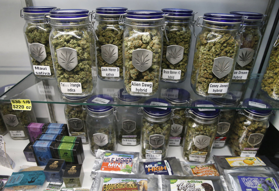 """In this Dec. 27, 2013 photo, marijuana and cannabis-infused products are displayed for sale at Medicine Man marijuana dispensary, which is to open as a recreational retail outlet at the start of 2014, in Denver. Colorado is making final preparations for marijuana sales to begin Jan. 1, a day some are calling """"Green Wednesday."""" (AP Photo/Brennan Linsley)"""