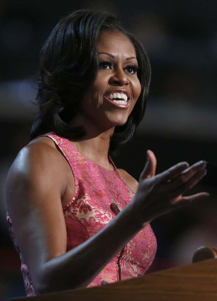 Photo - First Lady Michelle Obama addresses the Democratic National Convention in Charlotte, N.C., on Monday, Sept. 3, 2012. (AP Photo/Jae C. Hong)  ORG XMIT: DNC815