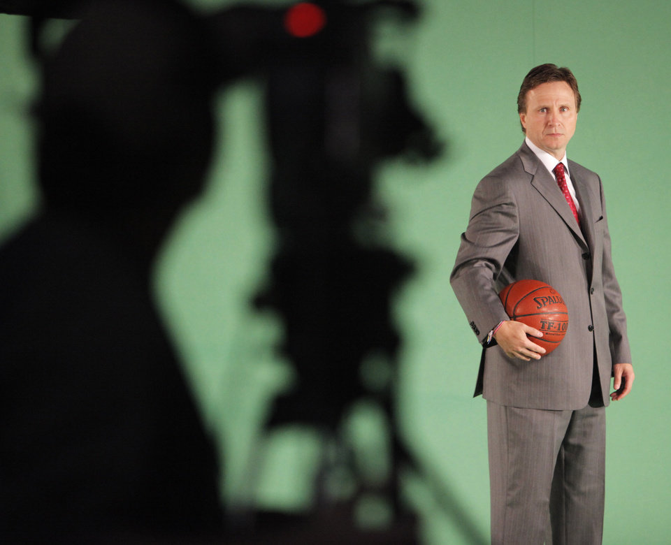 Photo - Head coach Scott Brooks is videotaped during media day for the Oklahoma City Thunder at the Ford Center in downtown Oklahoma City, Monday, Sept. 27, 2010. Photo by Nate Billings, The Oklahoman