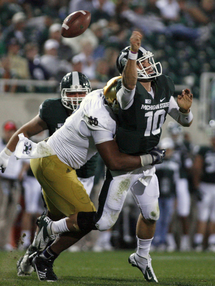 Photo -   Michigan State quarterback Andrew Maxwell (10) fumbles the ball as he is hit by Notre Dame's T.J. Jones during the fourth quarter of an NCAA college football game, Saturday, Sept. 15, 2012, in East Lansing, Mich. Michigan State recovered the fumble. Notre Dame won 20-3. (AP Photo/Al Goldis)