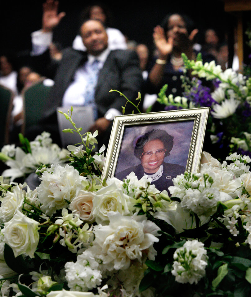 Photo - A portrait of Luper was placed among the flowers atop her casket. About 2,500 people celebrated the life and legacy of Oklahoma City civil rights pioneer Clara Mae Shepard Luper  during a lively service in the Cox Convention Center that lasted more than three hours, Friday,  June 17, 2011.  Luper died  last week at the age of 88. Photo by Jim Beckel, The Oklahoman