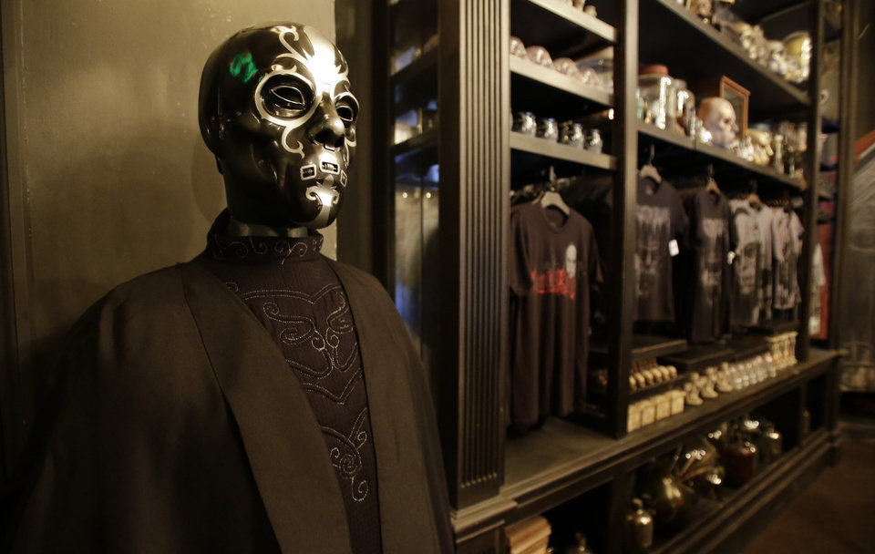 Photo - A cape is displayed along with other items available to guests during a preview of Diagon Alley at the Wizarding World of Harry Potter at Universal Orlando, Thursday, June 19, 2014, in Orlando, Fla. (AP Photo/John Raoux)