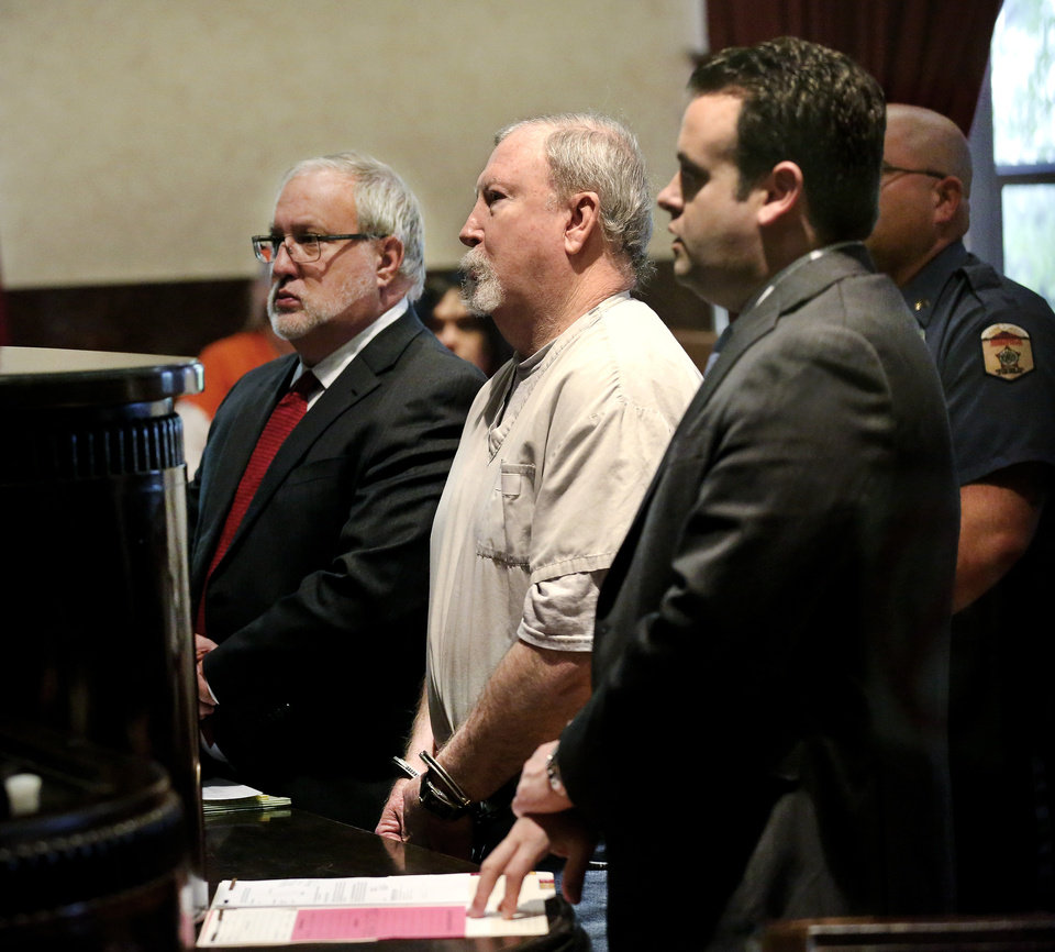 Photo - Former pharmacist Jerome Jay Ersland stands between his attorney, Doug Friesen, left, and a prosecutor at his sentencing Monday. Photo by Jim Beckel,  The Oklahoman  Jim Beckel -  THE OKLAHOMAN