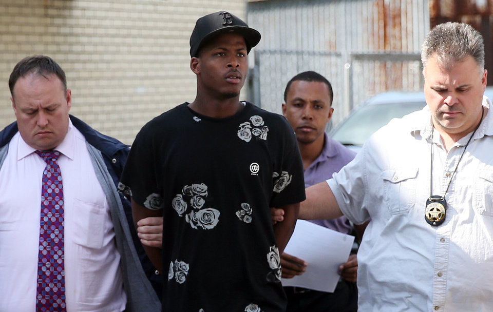 Photo - Shawn Scott, center, who with his younger brother Akien is accused of the Mother's Day second-line shooting which injured 20 people, is taken from the 5th District Police Station to Orleans Parish Prison in New Orleans on Thursday, May 16, 2013.   The Times-Picayune  (AP Photo/The Times-Picayune, Michael DeMocker ) MAGS OUT; NO SALES; USA TODAY OUT; THE BATON ROUGE ADVOCATE OUT