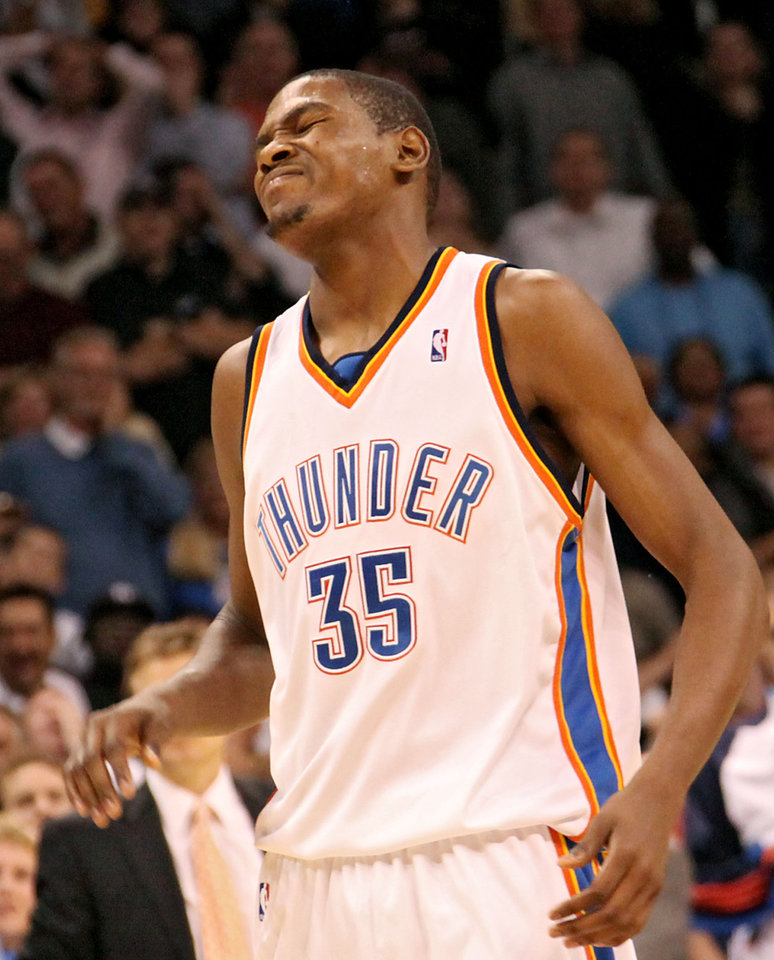 Photo - REACTION: Oklahoma City's Kevin Durant reacts as he misses his last shot in regulation time against Los Angeles during the NBA basketball game between the Los Angeles Lakers and the Oklahoma City Thunder at the Ford Center in Oklahoma City, on Tuesday, Nov. 3, 2009. The Thunder lost to the Lakers in overtime.  By John Clanton, The Oklahoman  ORG XMIT: KOD