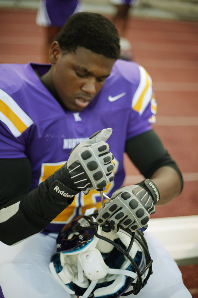NWC Timothy Harle adjusts his helmet at the Northwest Classen vs. Western Heights high school football game at Taft Stadium Thursday, September 20, 2012. Photo by Doug Hoke, The Oklahoman