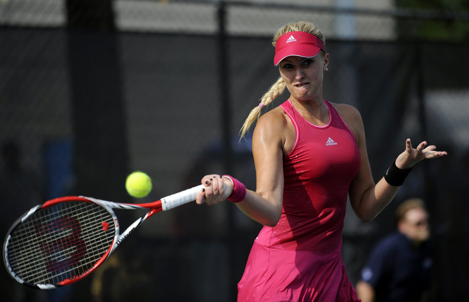 Photo - Kristina Mladenovic, of France, swings for the ball against Taylor Townsend during a match at the Citi Open tennis tournament, Wednesday, July 30, 2014, in Washington. (AP Photo/Nick Wass)