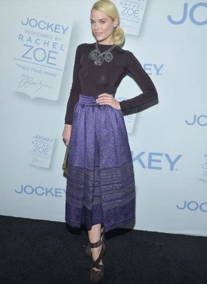"At the recent launch of Rachel Zoe's ""Major Must Haves"" collection for Jockey at Sunset Tower, Jaime King gave different shades of purple a whirl in a Christian Dior fall 2012 eggplant top and a skirt with sheer panels. She tied her Dior pumps like ballerina slippers and held on to a gold Jason Wu clutch."