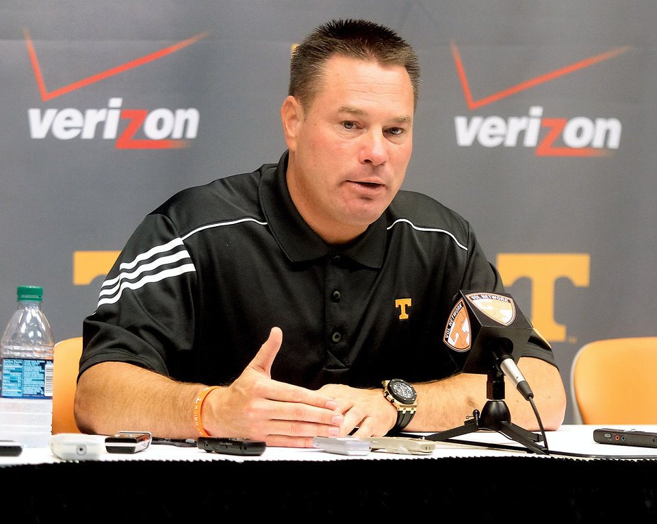 Photo - University of Tennessee football coach Butch Jones answers questions from media in the Stokley Media Center at Neyland Stadium at the University of Tennessee Football Media Day Thursday, July 31, 2014 in Knoxville, Tenn. (AP Photo/The Daily Times, Tom Sherlin)