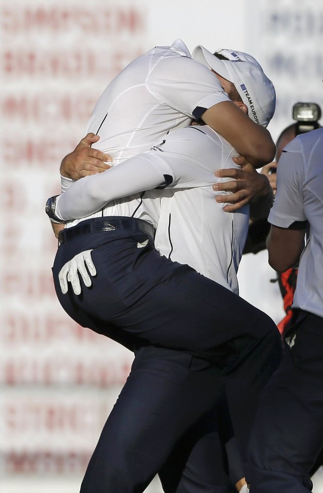 Europe's Martin Kaymer embraces Sergio Garcia after winning the Ryder Cup PGA golf tournament Sunday, Sept. 30, 2012, at the Medinah Country Club in Medinah, Ill. (AP Photo/Chris Carlson)  ORG XMIT: PGA195