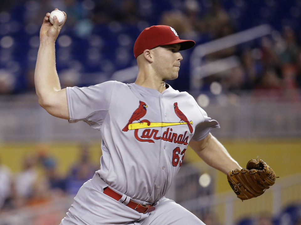 Photo - St. Louis Cardinals starting pitcher Justin Masterson throws in the first inning during a baseball game against the Miami Marlins, Wednesday, Aug. 13, 2014, in Miami. (AP Photo/Lynne Sladky)