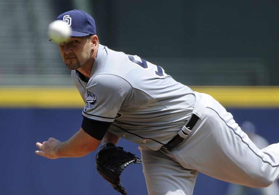 Photo - San Diego Padres' Jason Lane delivers to the Atlanta Braves in his first outing as a Padres starting pitcher during the first inning of a baseball game Monday, July 28, 2014, in Atlanta. (AP Photo/David Tulis)
