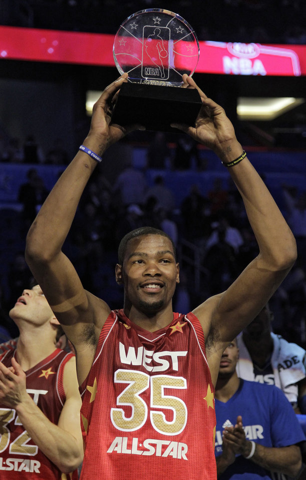 Western Conference\'s Kevin Durant, of the Oklahoma City Thunder, hoists the Most Valuable Player trophy following the NBA All-Star basketball game, Sunday, Feb. 26, 2012, in Orlando, Fla. The Western Conference won 152-149. (AP Photo/Chris O\'Meara)
