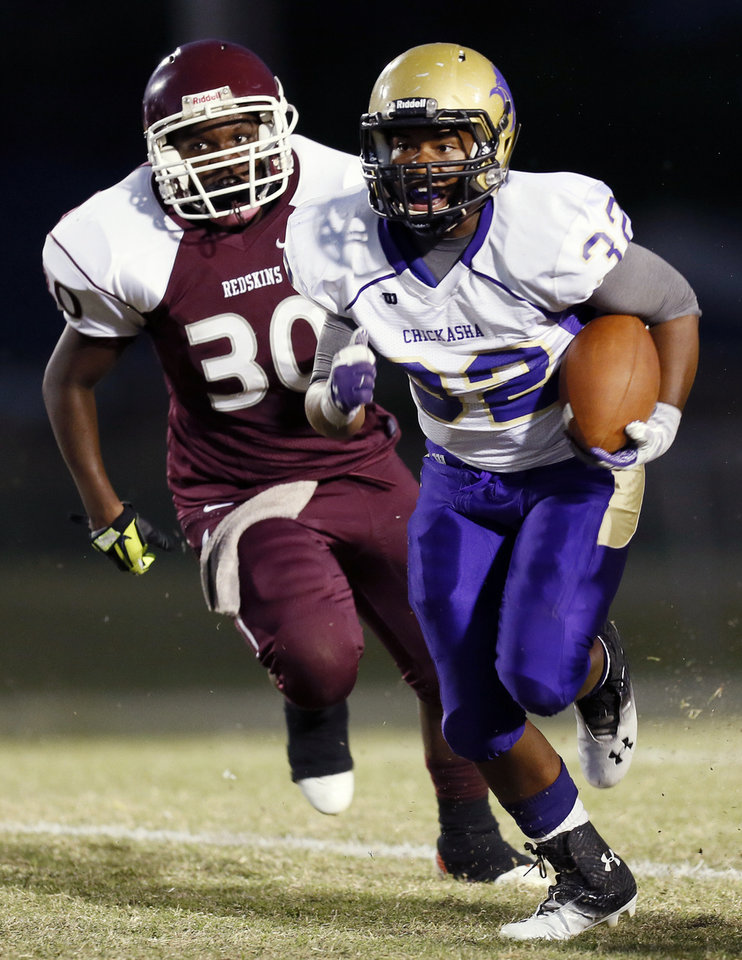 Chickasha's Tresjon Davis (32) runs from Capitol Hill's Dayquan Burden (30) during a high school football game between Chickasha and Capitol Hill at Star Spencer's Carl Twidwell Stadium in Spencer, Okla., Thursday, Oct. 3, 2013. Photo by Nate Billings, The Oklahoman