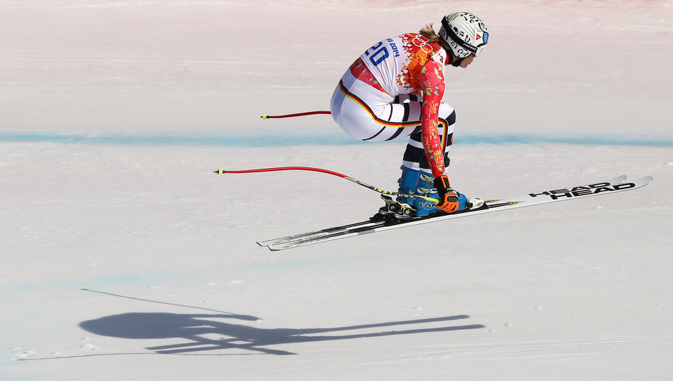 Photo - Germany's Maria Hoefl-Riesch jumps during the downhill portion of the women's supercombined at the Sochi 2014 Winter Olympics, Monday, Feb. 10, 2014, in Krasnaya Polyana, Russia. (AP Photo/Alessandro Trovati)