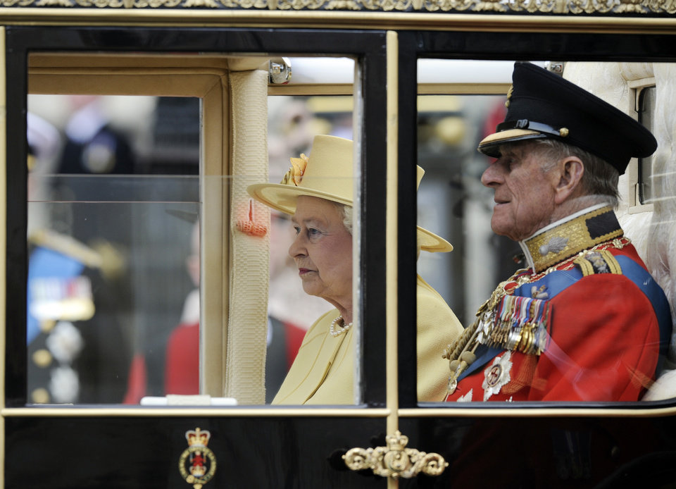 Photo - Britain's Queen Elizabeth II and Britain's Prince Philip sit in their carriage outside Westminster Abbey after the Royal Wedding for Britain's Prince William and his wife Kate, Duchess of Cambridge in London Friday, April, 29, 2011. (AP Photo/Martin Meissner) ORG XMIT: RWMG168