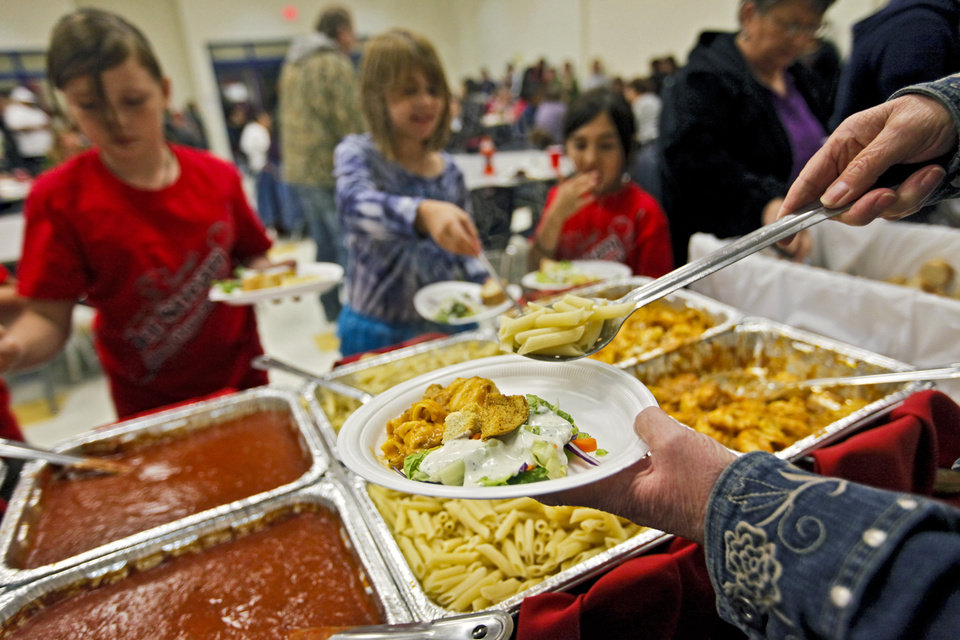 Photo - Supporters gather for dinner during a benefit dinner for the family of homicide victim Jasmen Gonzalez at John Glenn Elementary on Wednesday, Nov. 16, 2011. in Oklahoma City, Okla..  Photo by Chris Landsberger, The Oklahoman  ORG XMIT: KOD