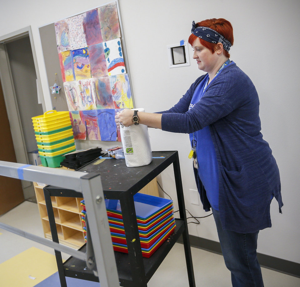 Photo - Art and music teacher Sarah Caputo sets up her classroom at the new facility for Positive Tomorrows, a school for homeless children, at 901 N Villa in Oklahoma City, Tuesday, Nov. 26, 2019. [Nate Billings/The Oklahoman]