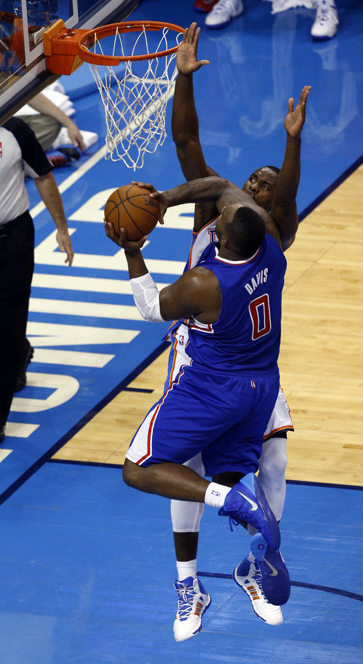 Photo - Oklahoma City's Serge Ibaka (9) defends against Los Angeles' Glen Davis (0) during Game 2 of the Western Conference semifinals in the NBA playoffs between the Oklahoma City Thunder and the Los Angeles Clippers at Chesapeake Energy Arena in Oklahoma City, Wednesday, May 7, 2014. Photo by Sarah Phipps, The Oklahoman
